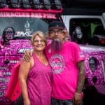 Breast cancer awareness Jeep with couple standing in front