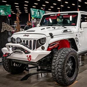 Rugged white Jeep with 'sinister' looking grill