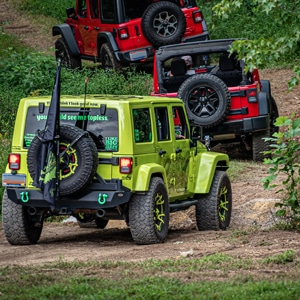 Jeeps running through an all terrain course