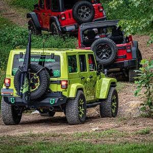 Jeeps running through an all terrain course