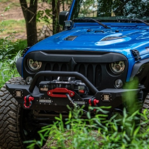 Blue Jeep with impressive towing capacity on the trail