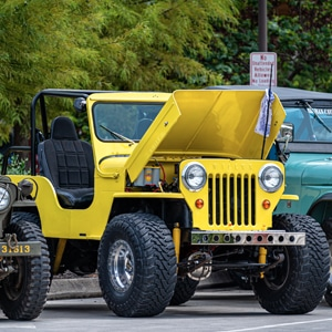 Yellow Jeep with engine on display