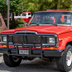 Orange classic Jeep on display