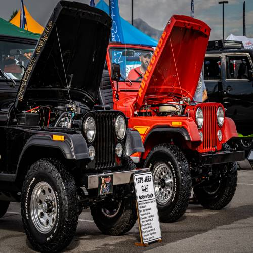 Red and Balck Jeep with hood up