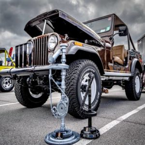 A brown Jeep with hood up