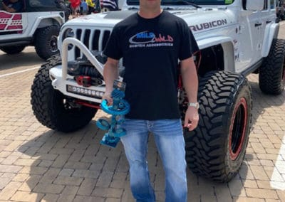 2021 Award winner man with white Jeep