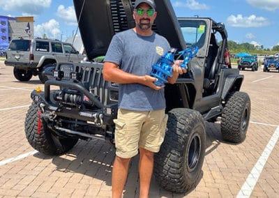 2021 Award winner man with charcoal metallic Jeep