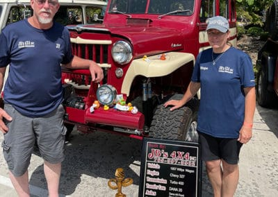 2021 Award winner couple with crimson and cream colored classic Jeep
