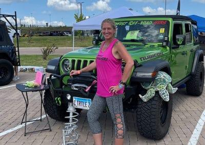 2021 Award Winner woman with Green Metallic colored Jeep