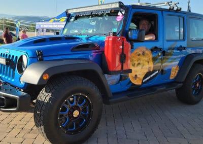 Blue metallic Jeep on display