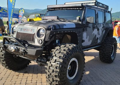 Gray and white camo Jeep on display
