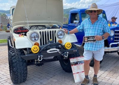 Man with white Jeep who was a Top 5 finisher in the Show and Shine